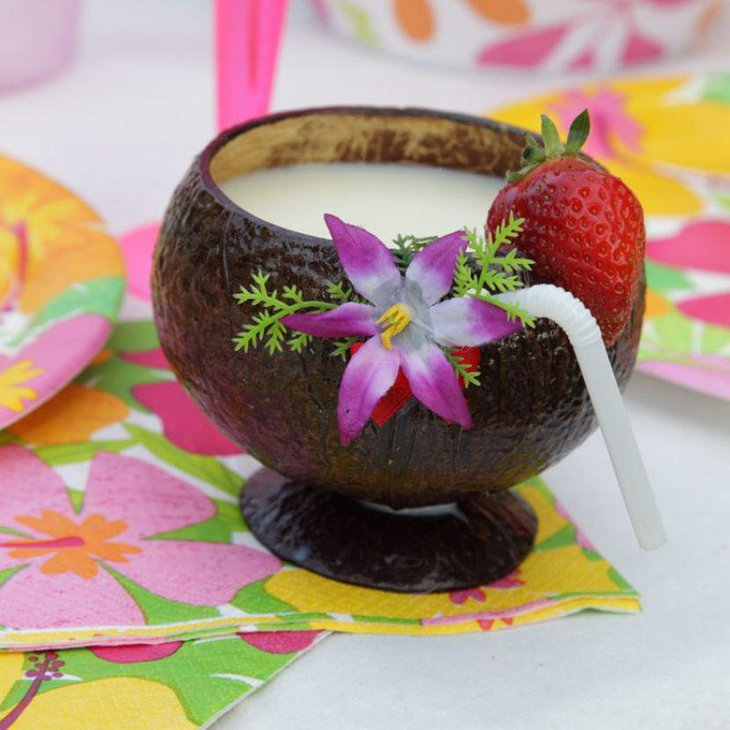 Fun coconut cup decor for summer birthday tables