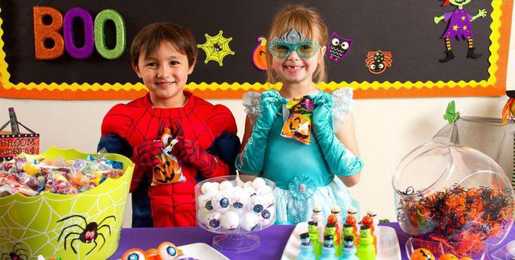 Fun kids Halloween treats table with monster eyeballs and spiders