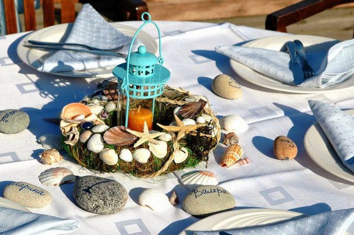 Garden party table decor with shells and blue lantern centerpiece