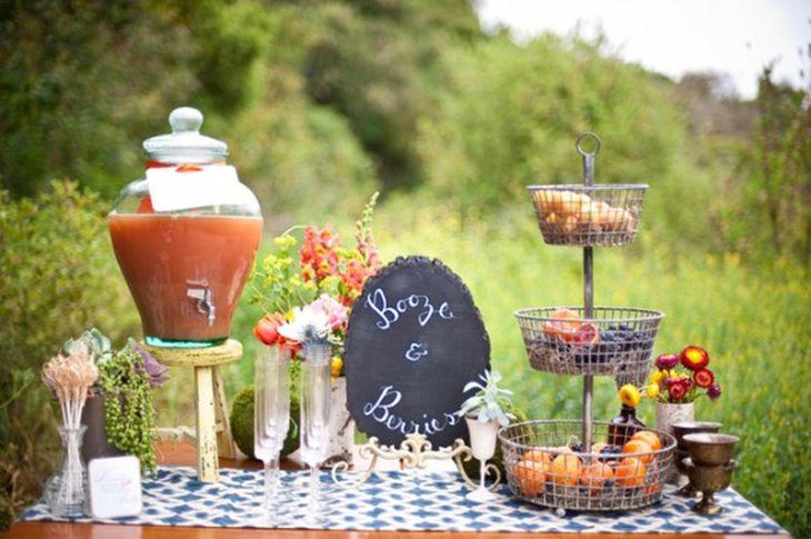 Garden party table setting with fruit punch bowl and berries