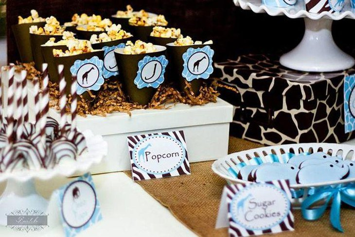 Giraffe themed popcorn decor for girl baby shower table