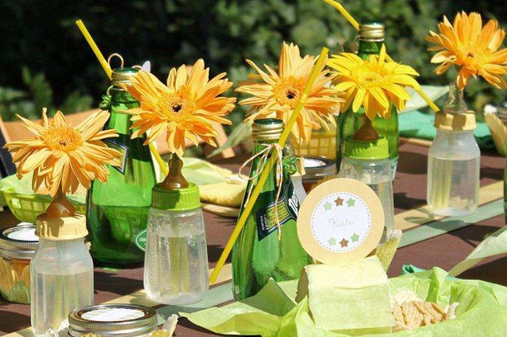 Girl baby shower table decor with bright yellow flower centerpieces