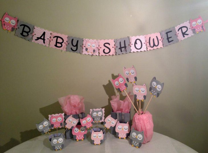 Girl baby shower table decorated with owl centerpieces