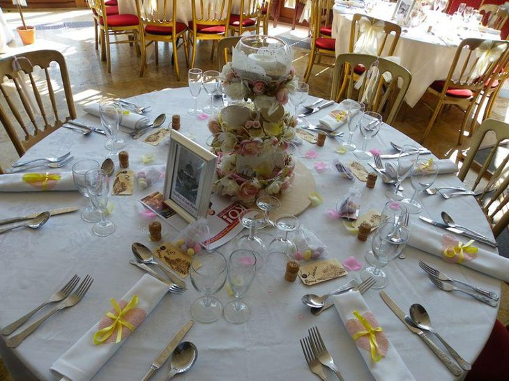 Glam floral and candle centerpiece on a wedding breakfast table