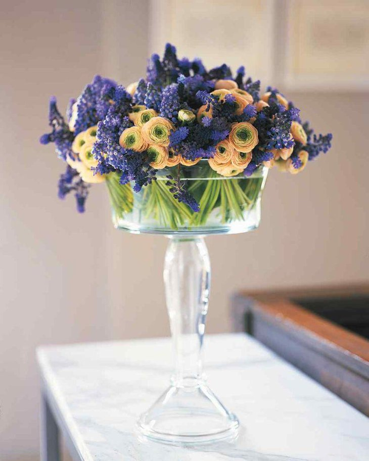 Glass compote floral centerpiece on spring table