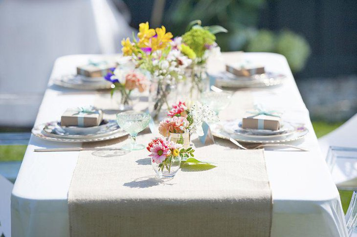Glass vase decorations on garden party table