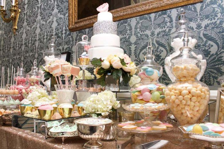 Gold and pastel decor on European dessert table