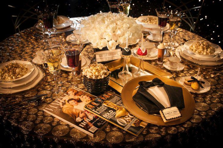 Golden accented Oscar themed party table decor