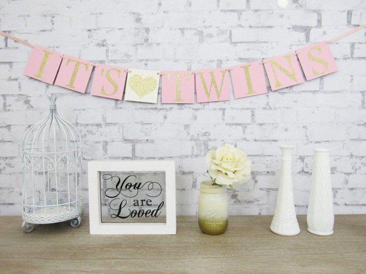 Golden accented twin baby shower table decor