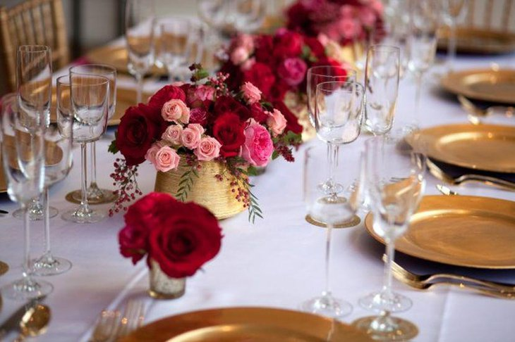 Golden floral vases and plates for winter wedding table