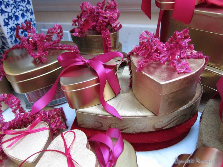 Golden heart shaped gift boxes vignette Valentines centerpieces