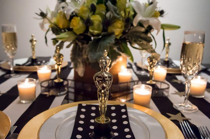 Golden Oscar statues seen decking up this dinner party table