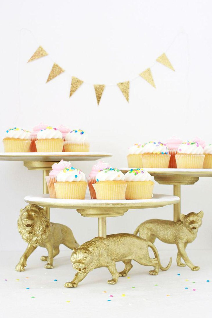 Golden vintage wild cat cake stand decor on tea party dessert table