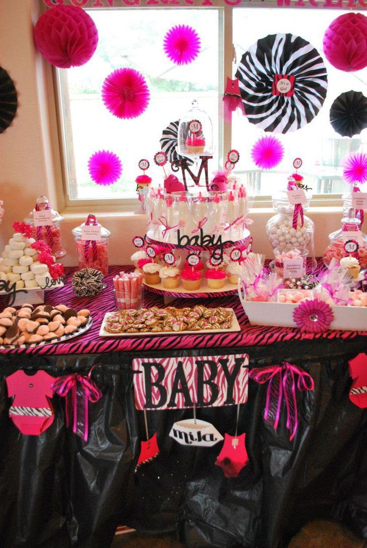 Gorgeous baby shower candy buffet table in pink accents