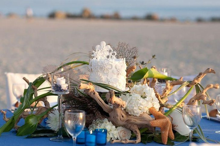 Gorgeous beach theme wedding centerpiece idea with driftwood