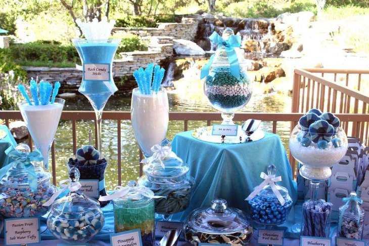 Gorgeous blue wedding candy table with blue rock candy and treats