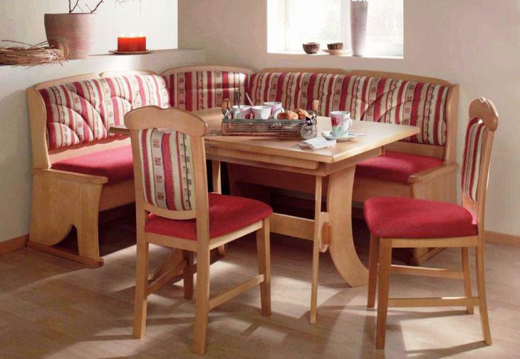 Gorgeous breakfast nook with red wooden sofa and chair and wooden table