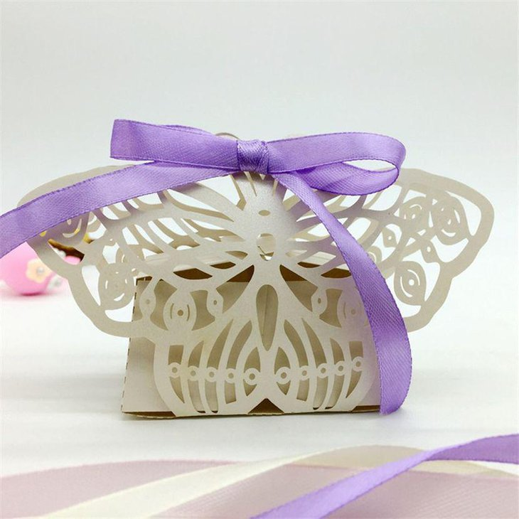 Gorgeous butterfly baby shower favor with purple ribbon