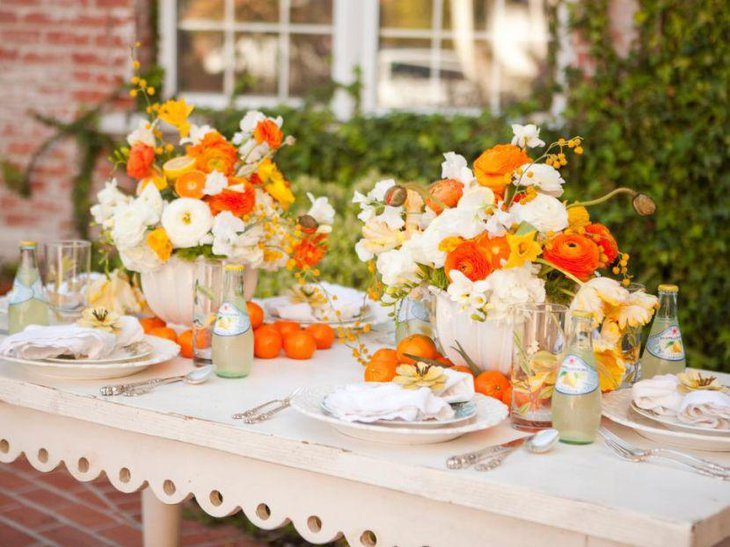 Gorgeous citrus and floral spring table setting