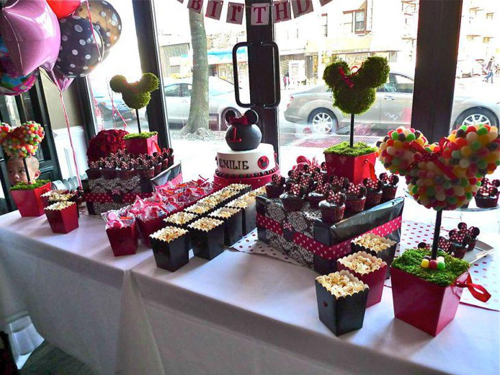 Gorgeous DIY Minnie Mouse topiary centerpiece on candy buffet table