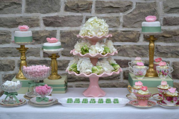 Gorgeous European dessert table decoration using tiered floral centerpiece and pink accents