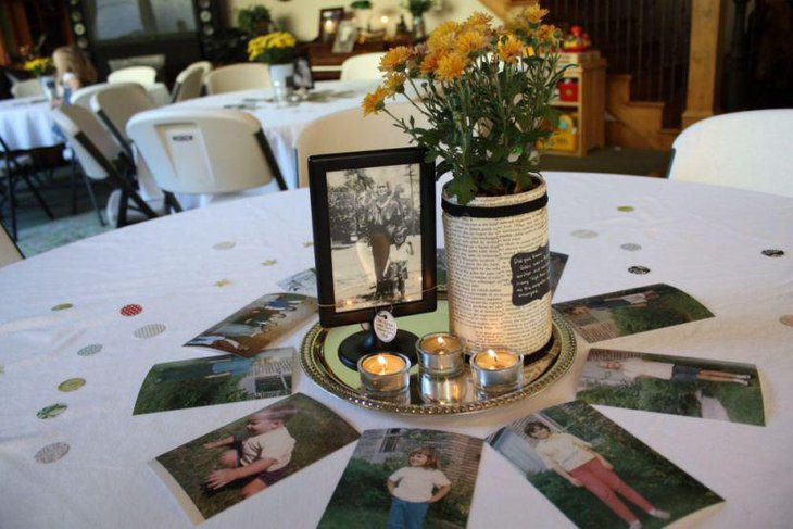 Gorgeous flowers and picture frame decor on 80th birthday table