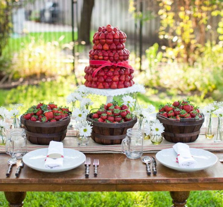 Gorgeous garden party table decor with apple holder and rustic baskets