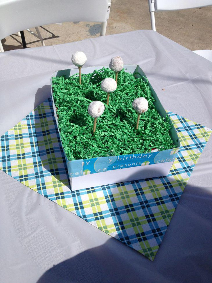 Gorgeous golf centerpiece for 80th birthday party table