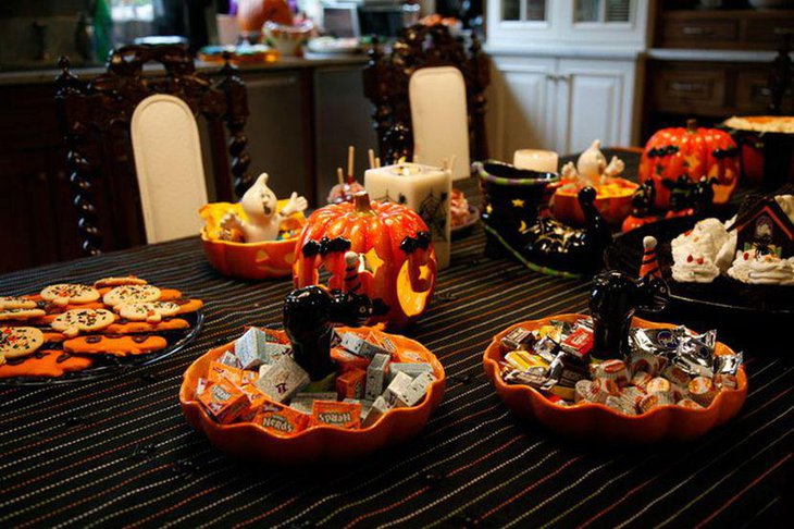 Gorgeous Halloween table decor with candles and candle lit pumpkins