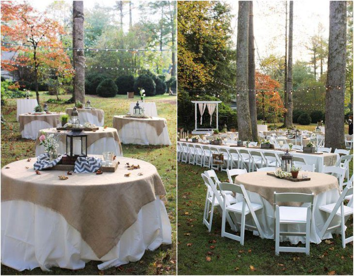 Gorgeous outdoor country wedding table decor with lanterns wood and candles