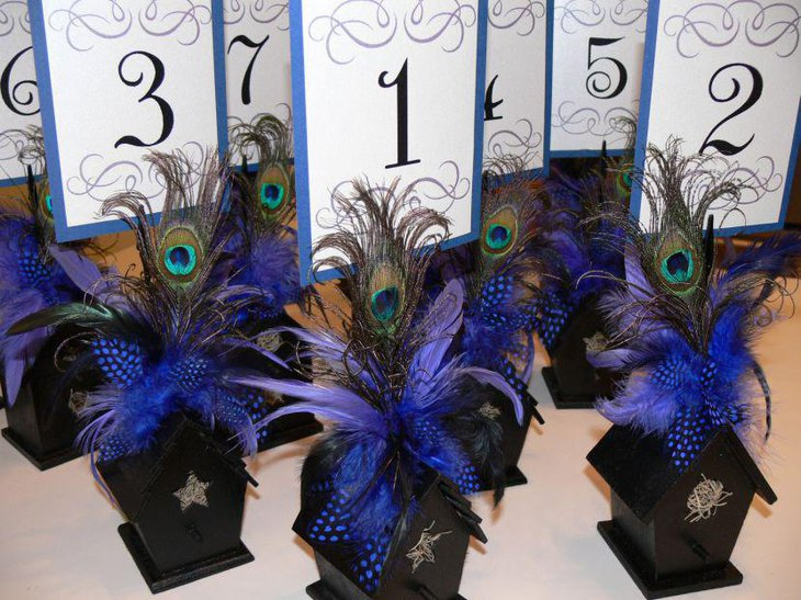 Gorgeous peacock feather centerpieces for bridal shower