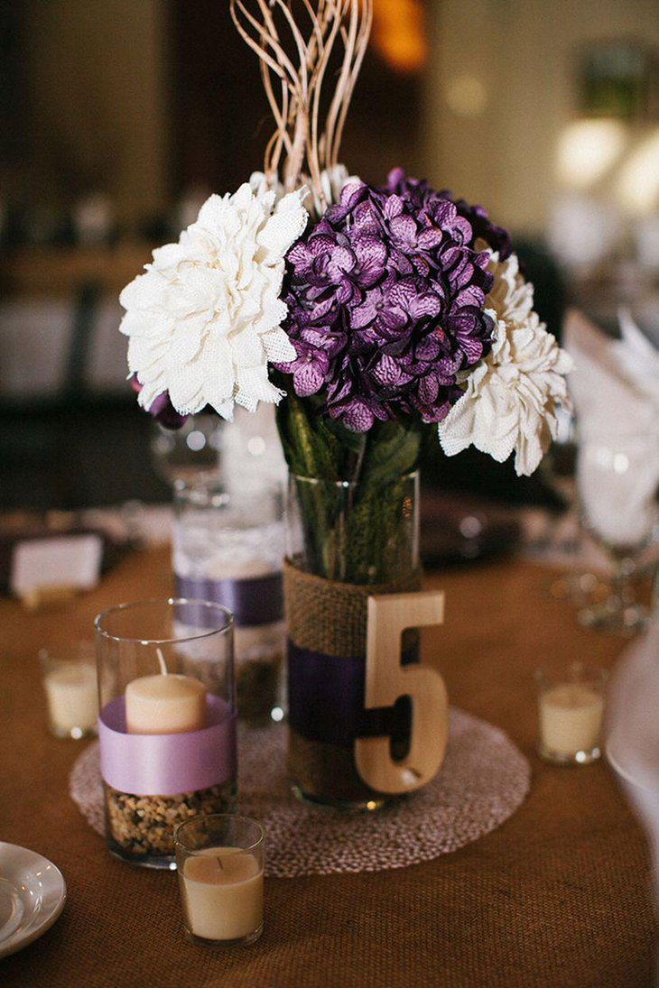 Gorgeous purple and white floral arrangement on a country wedding table