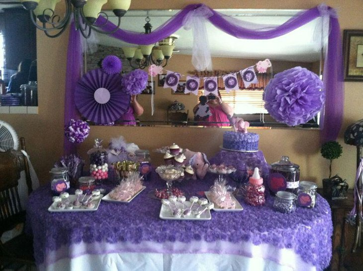 Gorgeous purple baby shower candy table decor