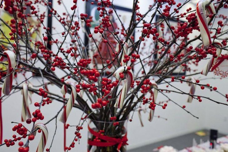 Gorgeous red winter table manzanita branch with berries centerpiece