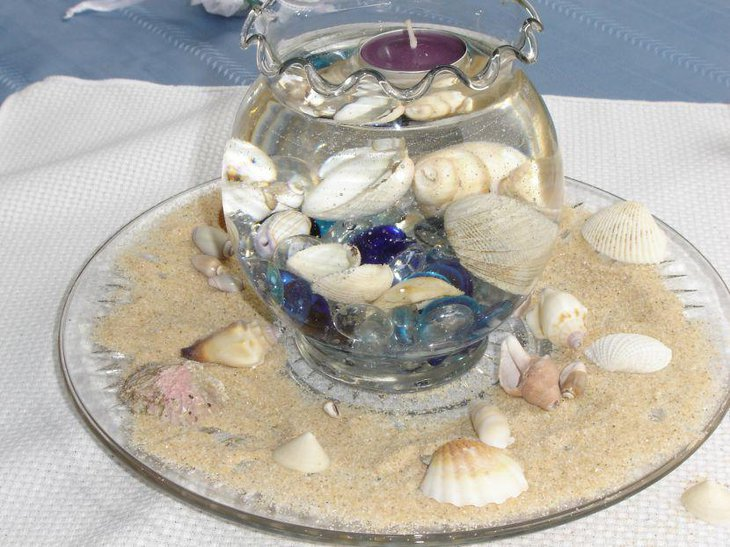 Gorgeous shell and glass bowl wedding centerpiece idea