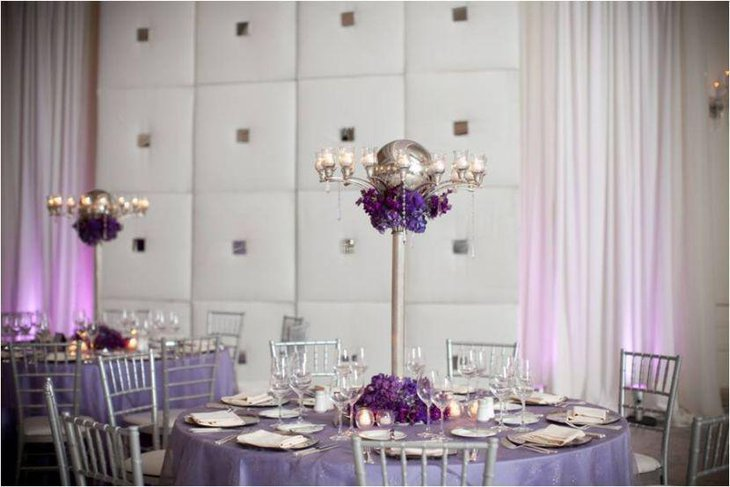 Gorgeous silver candleholder and violet floral arrangement for adult party table
