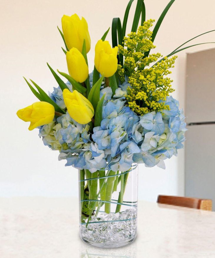Gorgeous tulips in vase table centerpiece for spring