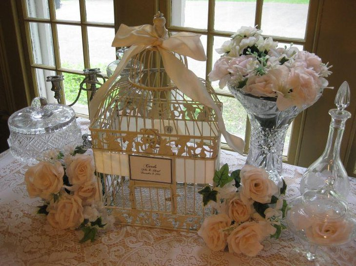 Gorgeous vintage birdcage cardholder centerpiece on wedding table 1