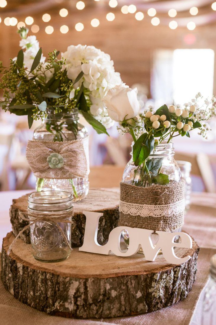 Gorgeous wooden centerpiece on a country wedding table