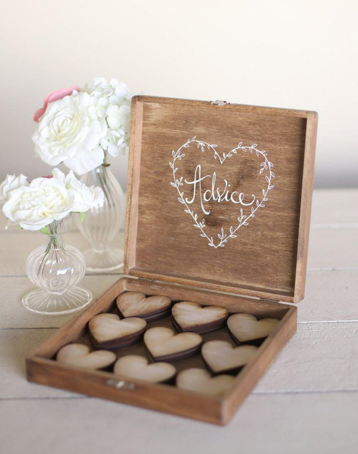 Gorgeous wooden chocolate box and floral vases deck up this country wedding table