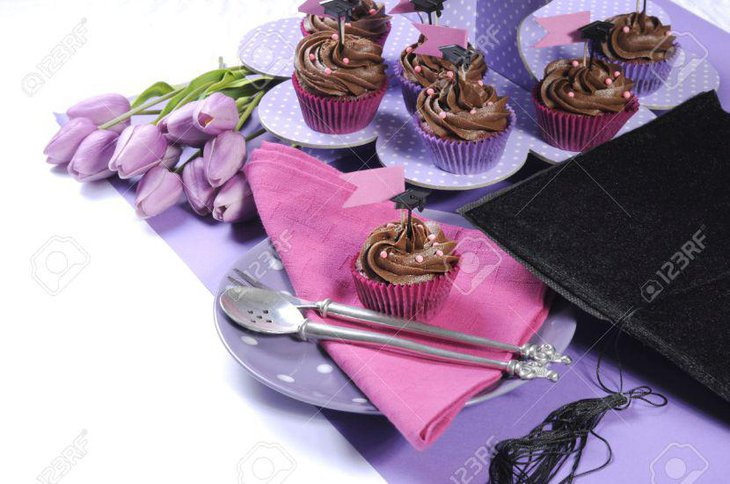 Graduation Day party table decoration with purple polka dot cupcake stands