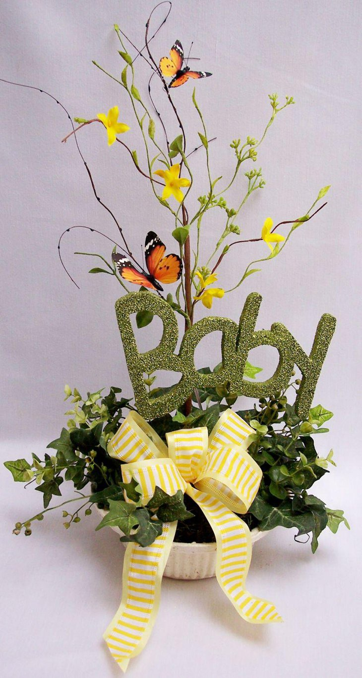 Green accented baby shower centerpiece with butterfly theme