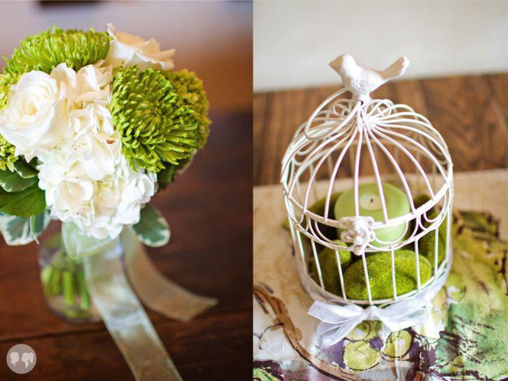 Green candle decor and moss birdcage centerpiece