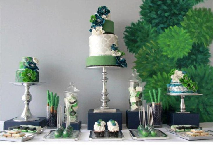 Green dessert table decorated with leaves