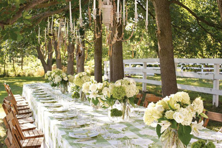 Green floral arrangements for garden party table