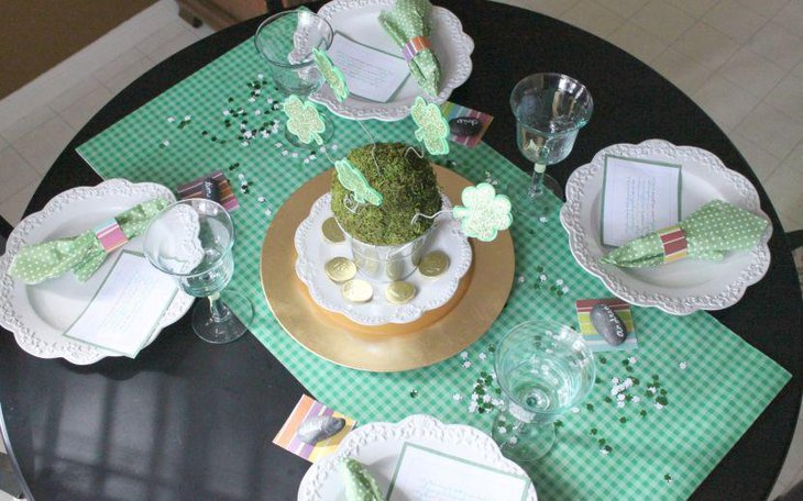 Green grass in bucket decorated with paper flowers for table centerpiece