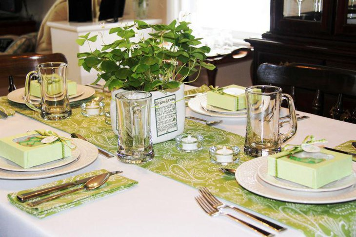 Green leaves in square glass table centerpiece for St Patricks Day
