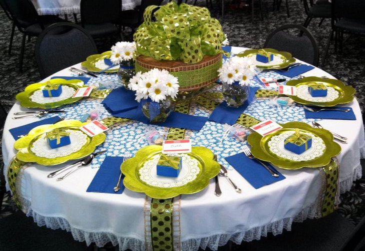 Green spring table centerpiece along with flowers