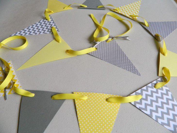 Grey and yellow paper garland for DIY baby shower table decoration