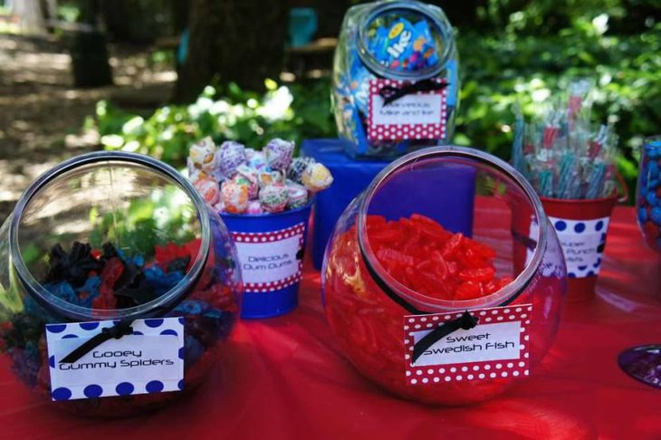 Gummy Spiders In Red Blue And Black On A Dessert Table